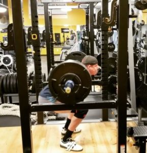 6 foot 9 power lifter squat bottom